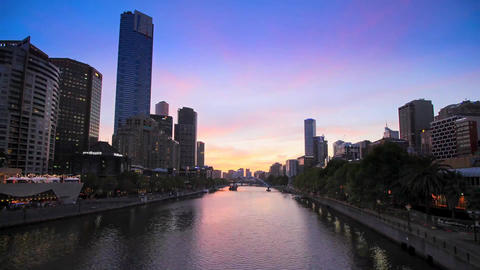 River in Melbourne. Sunset. on Either Bank of the River Standing Tall Buildings Footage