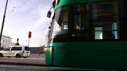 Modern tramway vehicle pass against Helsinki Cathedral, ride at Senate Square Footage