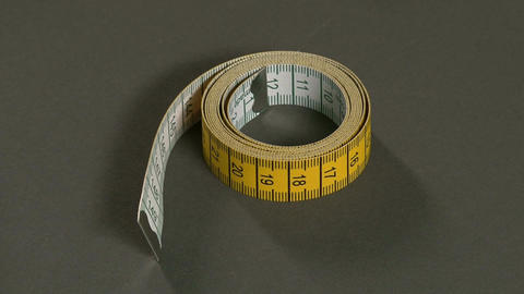 Tailor Picking Up the Tape Measure Footage