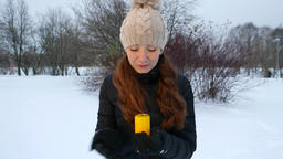 Woman fail in try to protect burning candle, hide it from wind by hand Footage