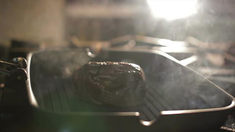 Closeup Meat Lump Grills on Pan in Steam Clouds in Kitchen Footage