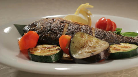 Fish Decorated with Vegetables Rounds on Plate Footage