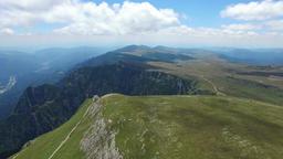 Turists enjoying the view from Caraiman Peak, Romania, aerial view Footage