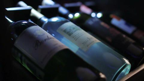 Closeup Camera Focus on Four Bottles of Wine Footage