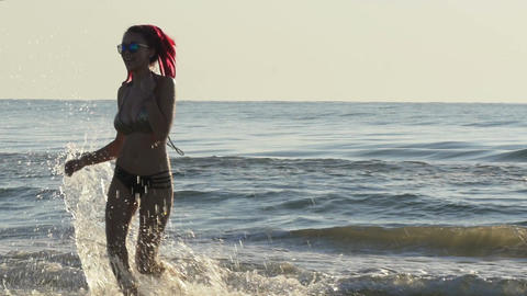 Young gorgeous woman coming out of the sea in slow motion Live Action