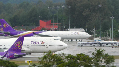 Boeing 747 taxis on wet runway after rain before taking off Footage