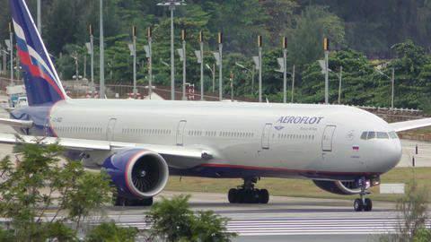 Boeing 777 of Aeroflot Airlines turns on wet runway after rain before taking off Footage