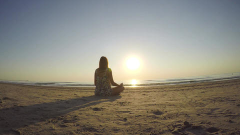 Woman meditating on the beach Footage