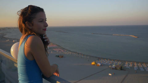 Gorgeous young teenager woman contemplating the landscape on a terrace with a se Live Action
