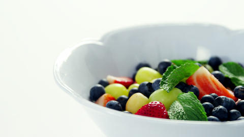 Various fruits and herbs in bowl Live Action