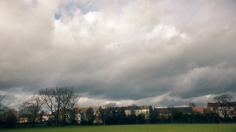 Time lapse. Beautiful clouds over the green field Footage