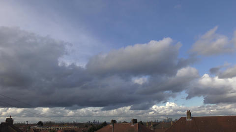 Time lapse. Beautiful clouds over the city Footage