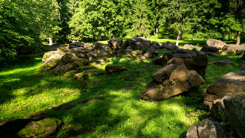 Sunbeams and shadows on the rocks in the park, timelapse, Ukraine. 4k footage Footage