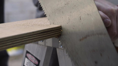 Hand Saw Cutting Wood Closeup Footage