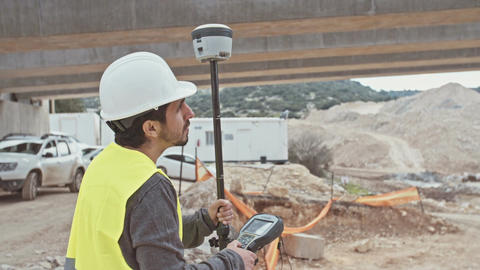 Construction engineer using a GPS device at a… Stock Video Footage