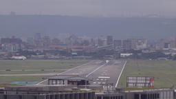 Airplanes landing, visible air pollution