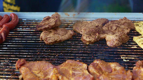 Rotate meat on a barbecue grill Footage