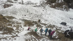 Tourists walk on tourist trail in crater of active volcano Footage