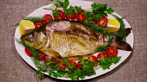 Fried fish on a white plate - stop motion animation Footage