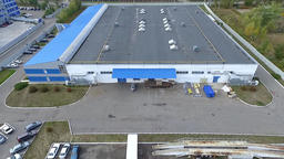 Flight over warehouse storage building exterior HD aerial video. Industrial area Footage
