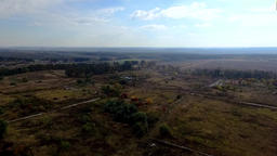 Aerial countryside village landscape HD video. Horizon: farm fields sky clouds Footage