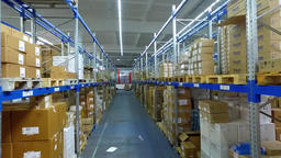 Camera moves between shelves boxes in storage warehouse interior HD video Footage