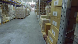 Shelves with cardboard boxes storage warehouse indoor interior HD video Footage