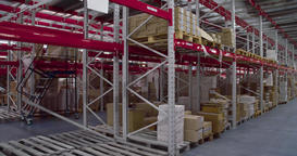 Panorama of shelves cardboard boxes storage warehouse 4k video. Stock interior Footage