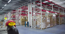 Warehouse worker transports boxes trolley loader 4k video. Delivery man unloads Footage