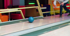Male friends playing bowling 4k leisure video. Man player throws rolls ball lane Footage