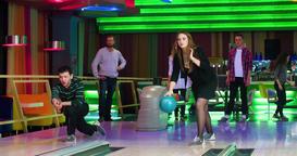 Friends playing having fun at bowling game 4k leisure video. Throwing ball Footage