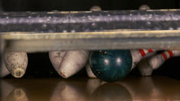 Bowling ball knocks down ten pin HD strike slow-motion video. Crashing skittle Footage