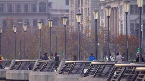 People hiking, running, walking at The Bund, Shanghai Footage