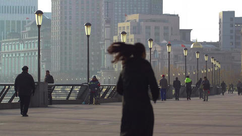 People walking along The Bund in the morning in Shanghai Footage