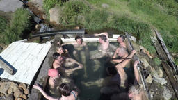 Top view of tourists take a bath in outdoors pool with thermal water Footage
