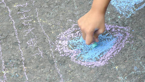 The child drawing a chalk on asphalt Footage