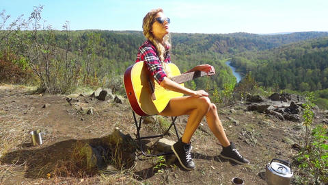 Woman Sitting On Camping Chair Above The River Footage
