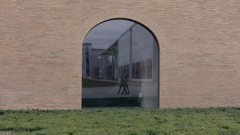 Walking couple in window reflection Footage