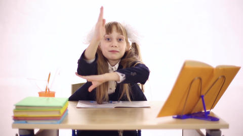 Schoolgirl sitting at school desk Filmmaterial