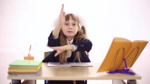 Schoolgirl sitting at school desk Footage