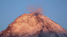 Beautiful top of Kamen Volcano with beautiful rocky peaks at sunrise Footage