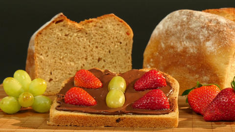 11796 dolly around buttermilk bread chocolate cream and fruits Footage