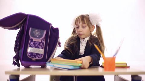 Schoolgirl with a huge backpack Footage