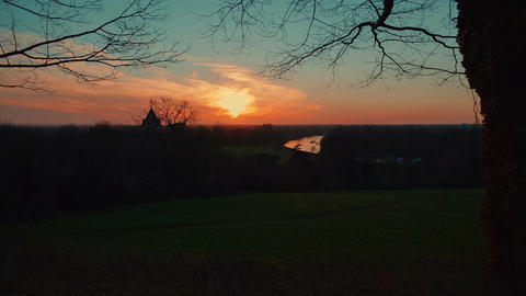 Gimbal shot featuring a sunset winter landscape in Richmond, England, UK Footage