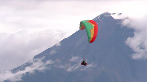 dual or tandem paragliding against volcano crater Footage
