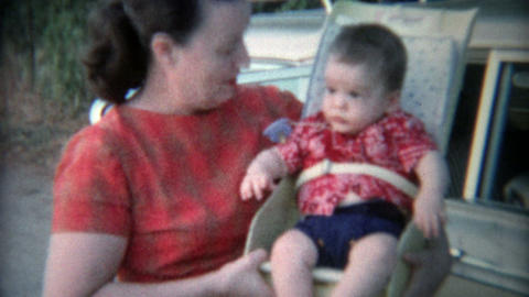 1969: Baby in early style car seat strapped tight Footage