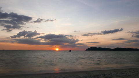 Tropical island seascape sunset, clouds move, evening to night time lapse Footage