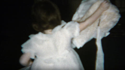 1960: Sister being funny and giving baby brother a dress to wear and then return Footage