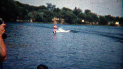 1960: Dad let's go of the rope while waterskiing in front of camera Footage