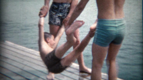 1960: Kid gets tossed into the lake by his older brothers Footage